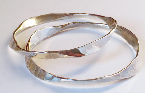 Fordged silver bangles