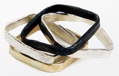Four Square Rings, one 9ct gold, two beaten silver and one oxidised silver worn together as one ring
